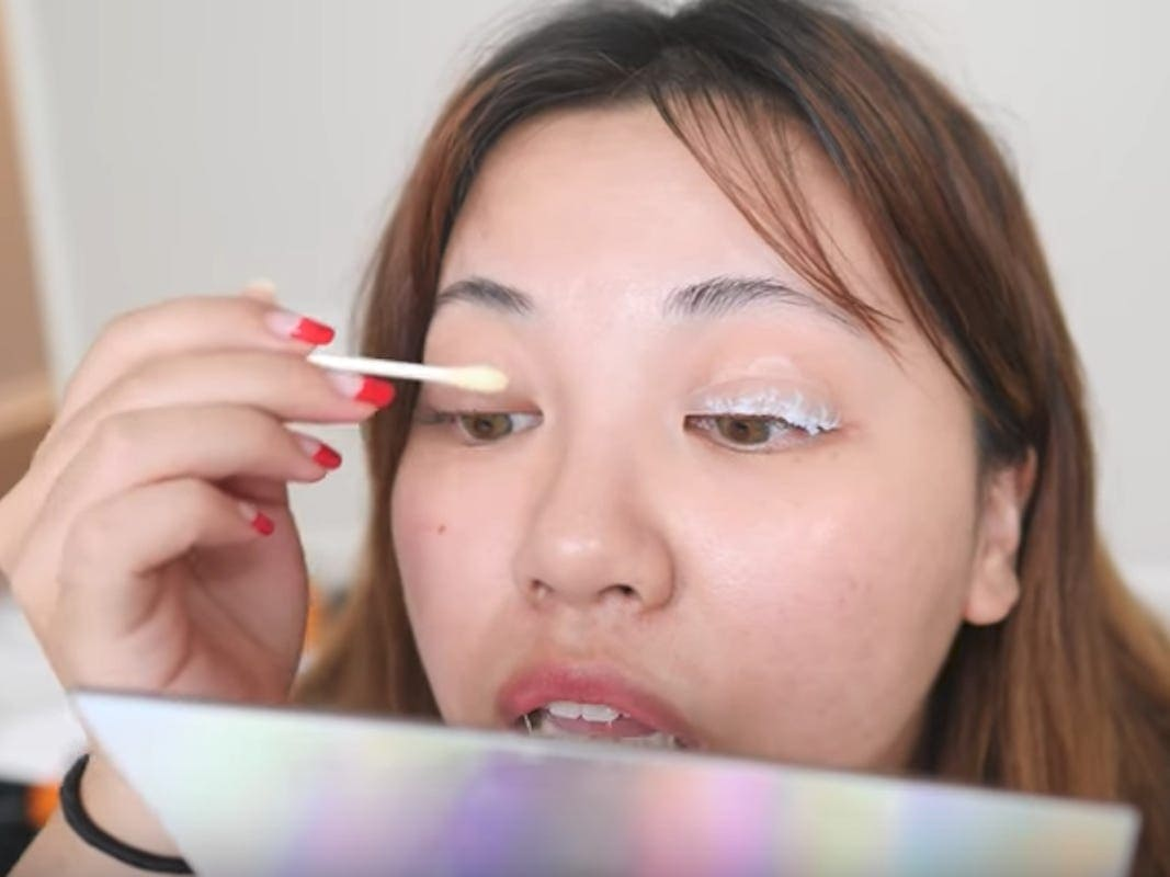 Girl applying lash lift by herself